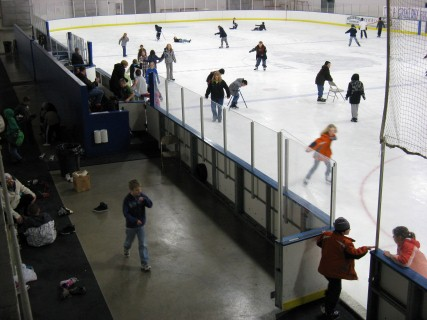 Kids practicing hockey on the ice rink